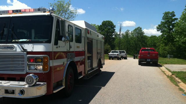 Firefighters and deputies along Current Drive in Greenville where deputies say a meth lab was found. (May 7, 2013/FOX Carolina)