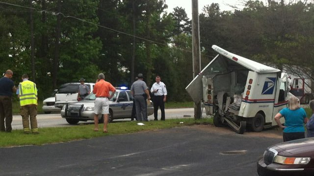 An iWitness photo of the damaged USPS truck was shoved off of the roadway. (May 8, 2013/Source: Greenville Motorsports Paint & Body)