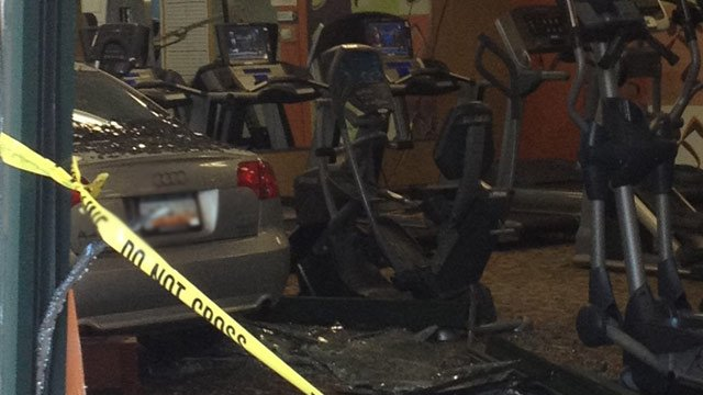 A car crashed into Anytime Fitness on Pelham Road on Thursday. (May 9, 2013/FOX Carolina)