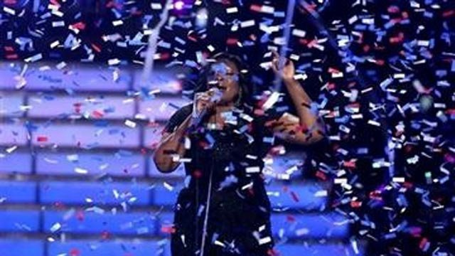 "Candice Glover performs on stage after she was announced the winner at the ""American Idol"" finale at the Nokia Theatre at L.A. (Photo by Matt Sayles/Invision/AP)"