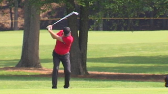 A John O'Hurley takes a swing on Day Two of the BMW Charity Pro-Am. (May 17, 2013/FOX Carolina)