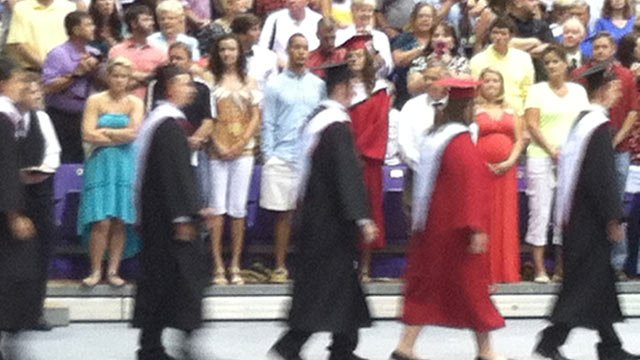 Blue Ridge High seniors walk across the stage while Coker stands in the front row of the crowd. (June, 5, 2013/FOX Carolina)