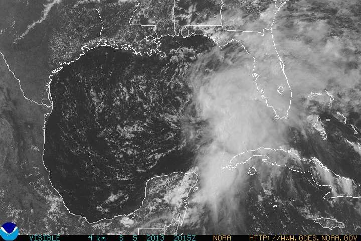 this is a visible satellite image from 5pm Thursday showing the tropical disturbance moving slowly toward northern Florida