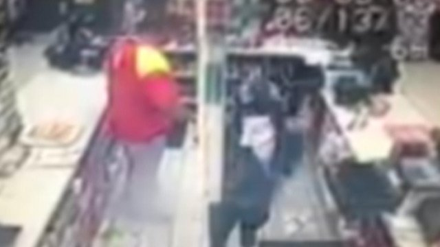 Deputies say the surveillance video shows the clerk (left) and two robbers in the store. (Source: Laurens Co. Sheriff's Office)