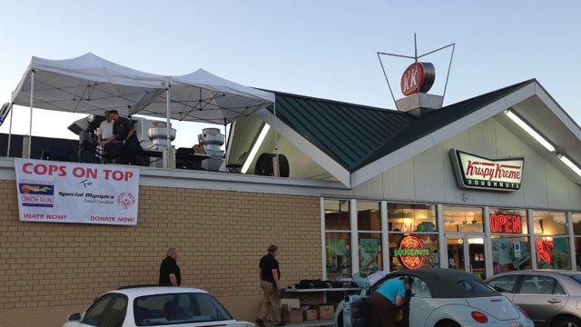 The Cops On Top for Special Olympics fundraiser is held atop the Krispy Kreme on N. Pleasantburg Drive. (June 14, 2013/FOX Carolina)