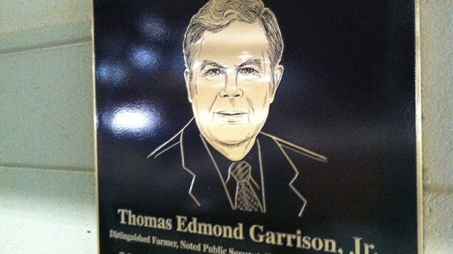 A marker honors T. Ed Garrison Jr. at the arena named for him at Clemson University. (June 17, 2013/FOX Carolina)