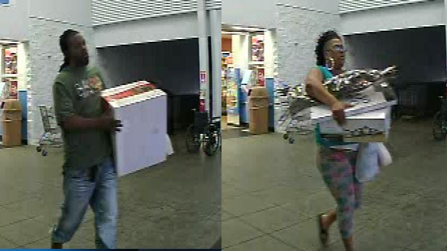 Walmart surveillance of the two people police are looking for. (Source: Greenville Police Dept.)