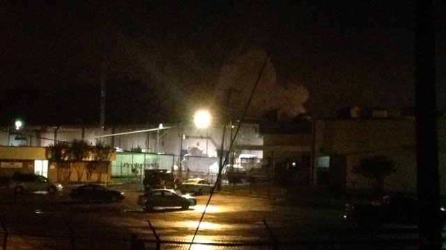 Smoke pours from the roof of Leigh Fibers on Syphrit Road. (June 18, 2013/FOX Carolina)