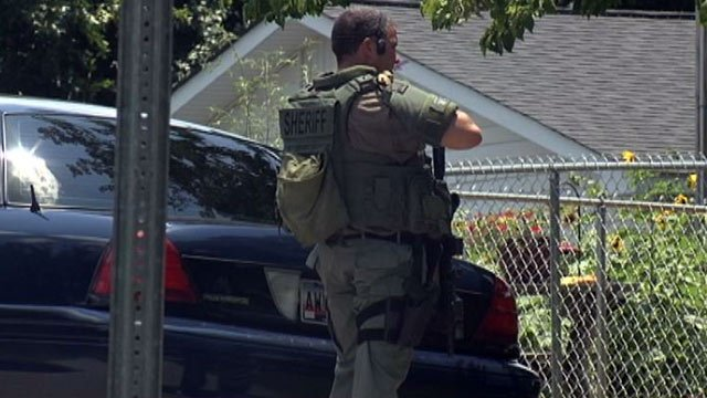 Deputies, Swat team responds to reports of armed man at a mobile home on Sulphur Springs Drive. (June 21, 2013/FOX Carolina)