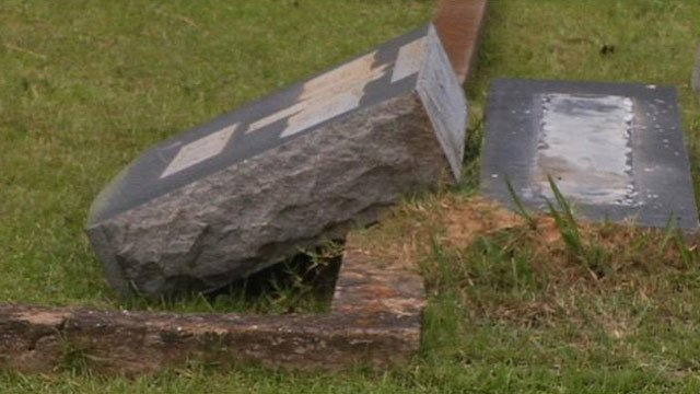 One of the overturned headstones at Oakwood Cemetery. (June 23, 2013/FOX Carolina)