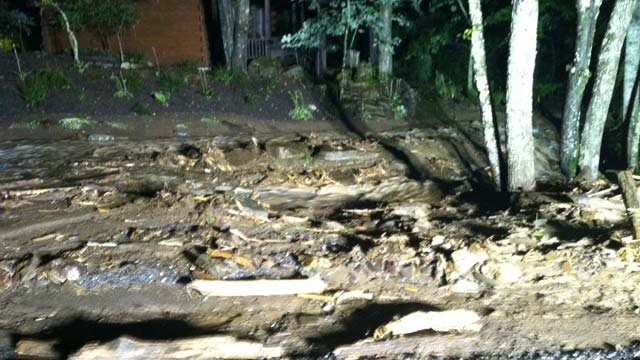 Debris, mud along Dick's Creek Road off of Highway 74. (July 4, 2013/FOX Carolina)