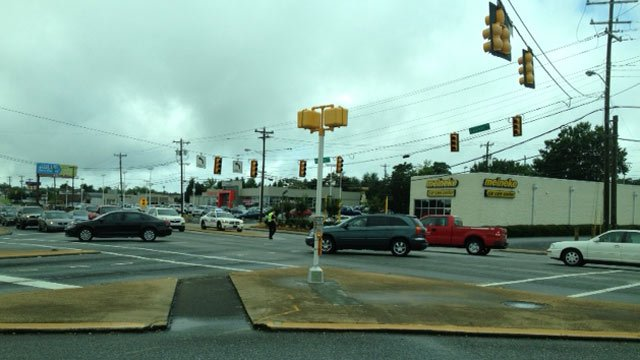 Greenville police direct traffic at the Laurens-Haywood Road intersection. (July 4, 2013/FOX Carolina)