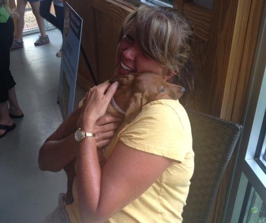 A woman adopts a dog at Greenville County Animal Care Services. (July 6, 2013/FOX Carolina)