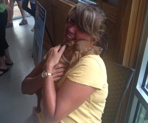 A woman adopts a dog at Greenville County Animal Care Services. (July 6, 2013/FOX Carolina)