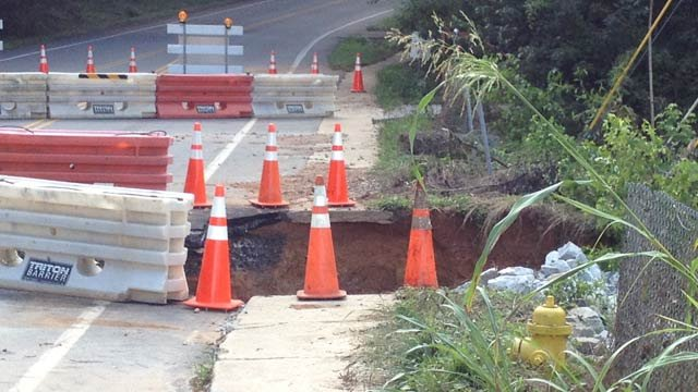 Corn Road is closed because of a sinkhole after heavy rainfall. (July 9, 2013/FOX Carolina)