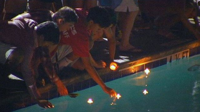 Candles were lit during a vigil for the Antonakos family at the Gower Estates Pool on Tuesday. (July 9, 2013/FOX Carolina)