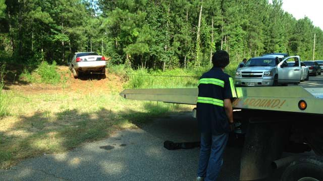 The Iva Police Dept. car is found and towed. (July 10, 2013/FOX Carolina)