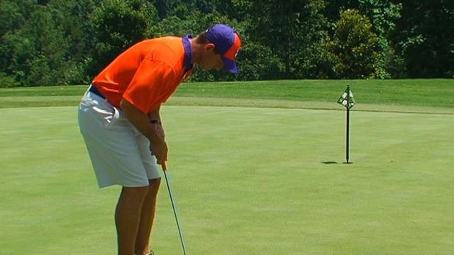 Clemson University Football Head Coach Dabo Swinney puts during Tuesday's media golf event. (July 16, 2013/FOX Carolina)