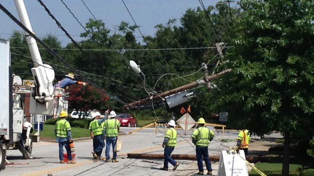 The broken power pole hangs across lines in Simpsonville. (July 18, 2013/FOX Carolina)