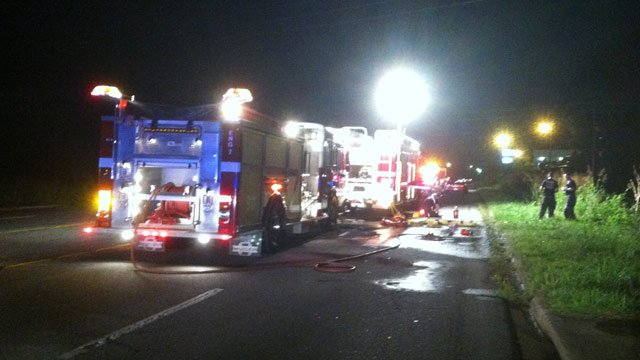 Firefighters and officials respond to a fatal crash along Augusta Road. (July 20, 2013/FOX Carolina)