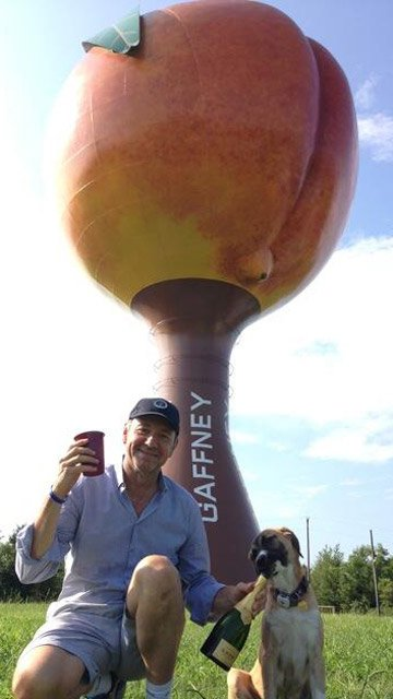 Kevin Spacey posing in front of the peach in Gaffney (Source: Twitter)