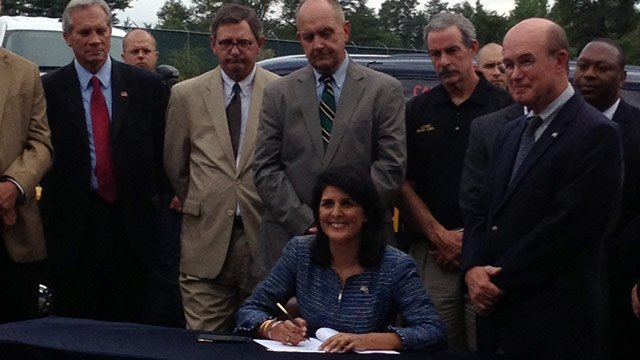 South Carolina Governor Nikki Haley signs the bill in Taylors. (Aug. 1, 2013/FOX Carolina)