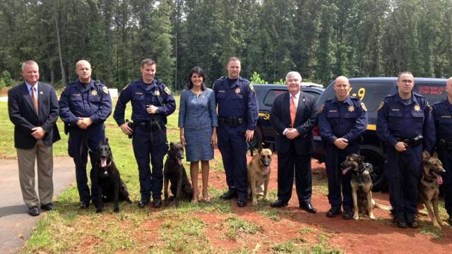 South Carolina Governor Nikki Haley with K9 officers and deputies. (Aug. 1, 2013/FOX Carolina)