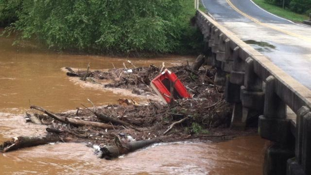 A nearly 10' boat caught in debris along a creek hitting Maw Bridge Road in Pickens Co. (Aug. 7, 2013/FOX Carolina)