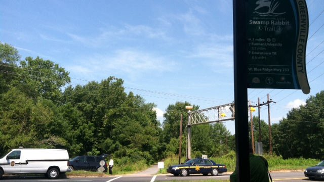 Deputies and the coroner respond to the Swamp Rabbit Trail at Highway 253. (Aug. 12, 2013/FOX Carolina)