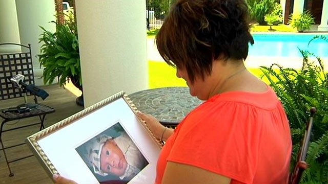 Felicia Dube holds a photo of her son Carter. (File/FOX Carolina)