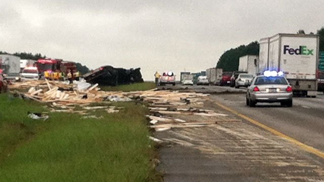 Lumber, debris scattered across the median is blocking southbound and northbound traffic. (Aug. 21, 2013/FOX Carolina)