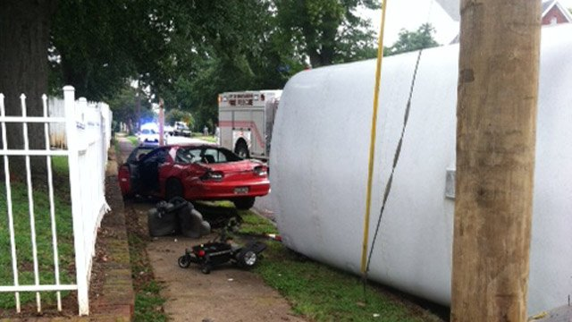 The overturned Housing Authority bus and Camaro. (Aug. 21, 2013/Spartanburg Public Safety Dept.)