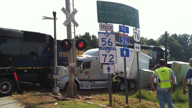 The wrecked truck and stopped train in Clinton. (Aug. 29, 2013/FOX Carolina)