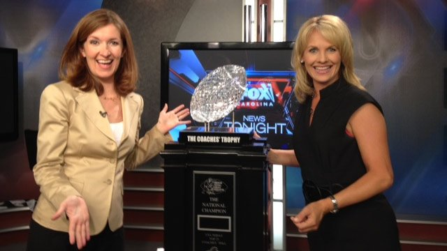 FOX Carolina's Kendra Kent and Diana Watson with The Coaches' Trophy as it makes it way through the Upstate. (Aug. 29, 2013/FOX Carolina)