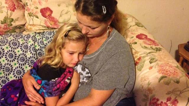 Audrea Summerall comforts her daughter after the death of the family dog. (Sept. 3, 2013/FOX Carolina)