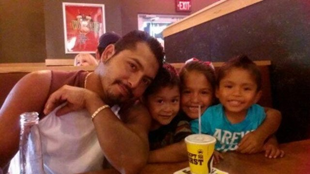 Carlos Garcia with his three children. (Courtesy: Garcia family)