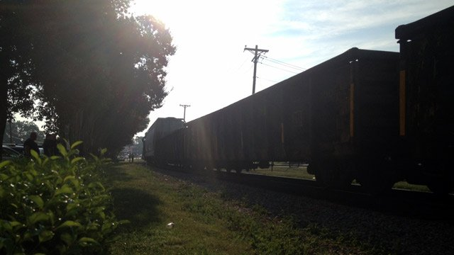 The stopped train along the tracks in downtown Clinton. (Sept. 5, 2013/FOX Carolina)