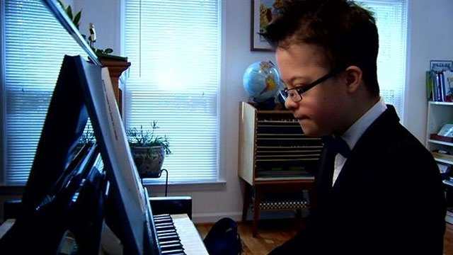 Peter Rosset plays the piano at home. (Sept. 5, 2013/FOX Carolina)