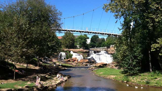 The Liberty Bridge goes over the Reedy River in Falls Park in downtown Greenville. (File/FOX Carolina)