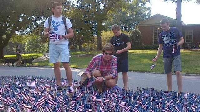 Furman students set out American flags on campus. (Source: Shane F.)