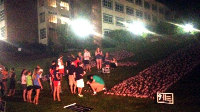 Clemson students set out American flags on campus. (Sept. 10, 2013/FOX Carolina)