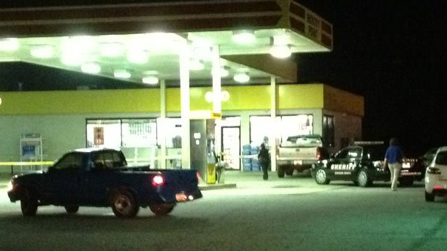 Anderson County deputies roped off a crime scene at the Hickory Point gas station. (Sept. 11, 2013/FOX Carolina)