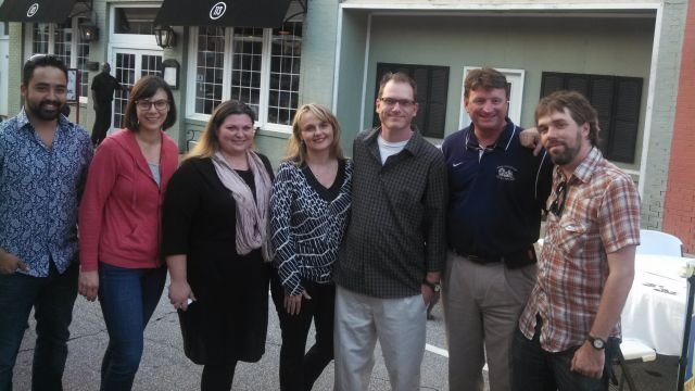 Screenwriter Jason Shirley (3rd from right) poses for a photo with Mayor Dan Alexander (2nd from right) and others in Seneca. Photo courtesy: Dan Alexander
