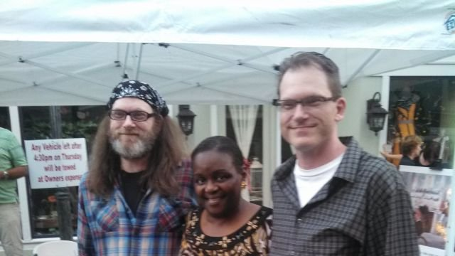 Screenwriter Jason Shirley (right) poses for a photo with people  in Seneca. Photo courtesy: Dan Alexander