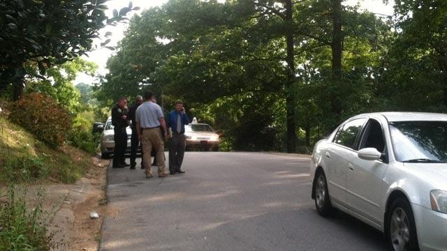 Investigators near the scene of an officer-involved shooting in Asheville. (Sept. 29, 2013/FOX Carolina)