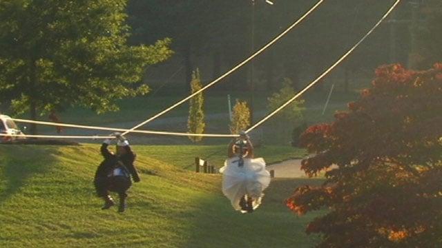 Lauren and Ben Youngkin zipline into their Asheville wedding ceremony. (Sept. 28, 2013/FOX Carolina)