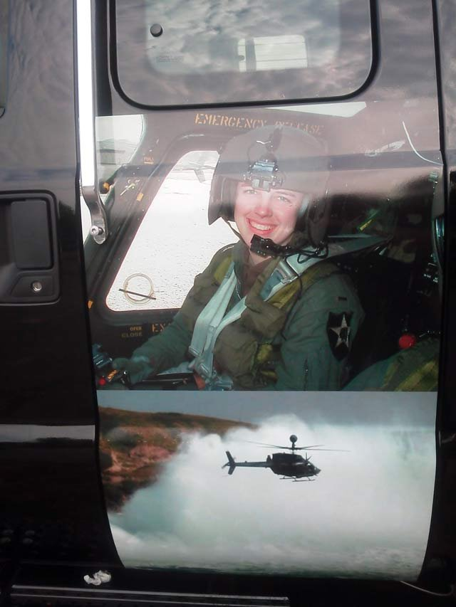 A photo of the painting of Capt. Kimberly Hampton that is on one of the stolen wreckers from Red's. (Source: Red Bordner)