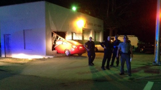 Scene of the crash into the auto shop. (Oct. 1, 2013/FOX Carolina)