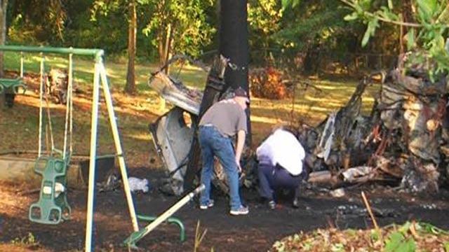 Officials investigate the single-SUV crash. (Oct. 3, 2013/FOX Carolina)