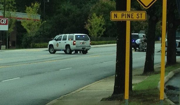 Spartanburg police have East St. John Street blocked at the QT where the bomb squad robot was investigating a bag. (Oct. 7, 2013/FOX Carolina)